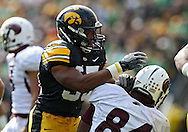 September 24, 2011: Iowa Hawkeyes linebacker Marcus Collins (55) is pumped up after a play during the first quarter of the game between the Iowa Hawkeyes and the Louisiana Monroe Warhawks at Kinnick Stadium in Iowa City, Iowa on Saturday, September 24, 2011. Iowa defeated Louisiana Monroe 45-17.
