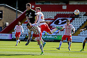 York City midfielder James Berrett beats Stevenage Midfielder Charlie Lee to the header  during the Sky Bet League 2 match between Stevenage and York City at the Lamex Stadium, Stevenage, England on 12 September 2015. Photo by Simon Davies.