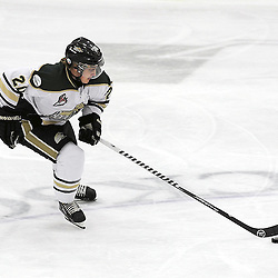 COBOURG, ON - Dec 23 : Ontario Junior Hockey League Game Action between the Cobourg Cougars and the Buffalo Jr. Sabres, Connor Hogg #20 of the Cobourg Cougars Hockey Club skates with the puck during second period game action.<br /> (Photo by Andy Corneau / OJHL Images)