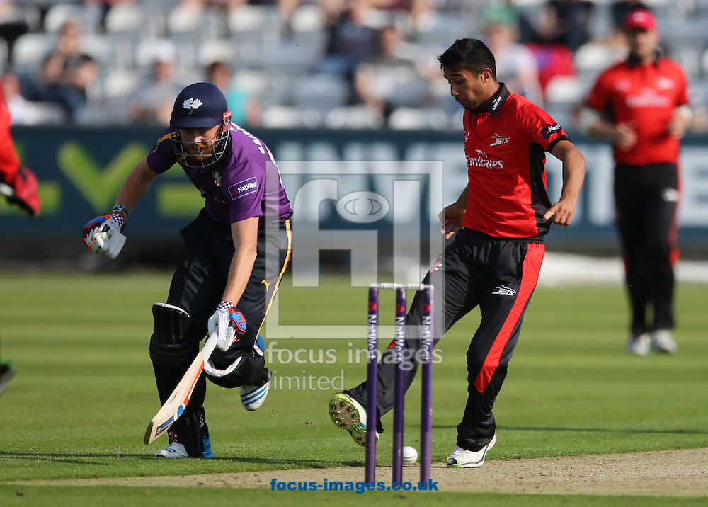 Usman Arshad (r) of Durham Jets attempts to run out Jonathan Bairstow of Yorkshire Vikings during the Natwest T20 Blast match at Emirates Durham ICG, Chester-le-Street<br /> Picture by Simon Moore/Focus Images Ltd 07807 671782<br /> 11/07/2014