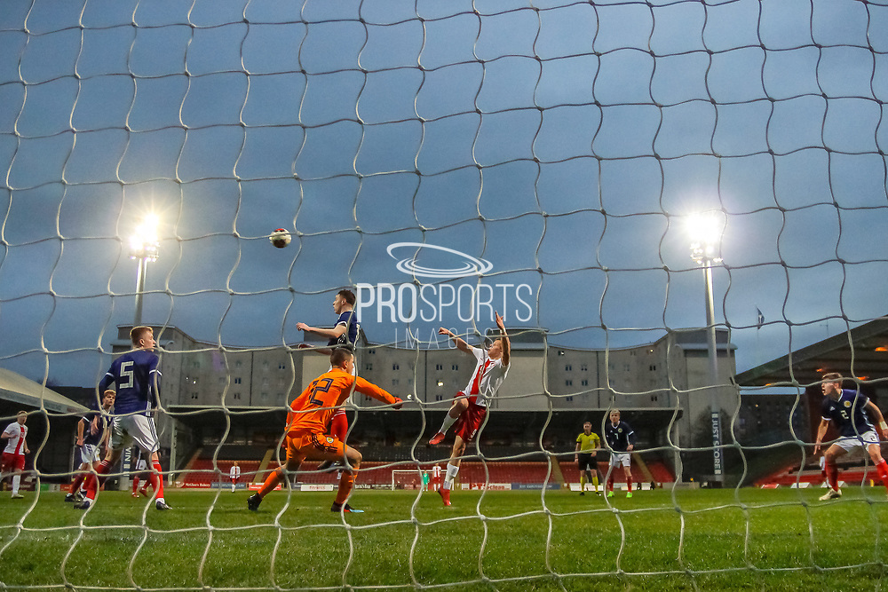 Almost a late upset as the ball comes in and Hubert Turski skews his header wide of the mark during the U17 European Championships match between Scotland and Poland at Firhill Stadium, Maryhill, Scotland on 26 March 2019.