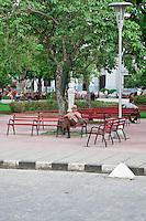 Man sitting in the central square of Santa Clara, Cuba