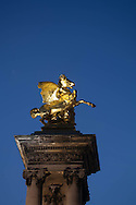 France. Paris. the gold statue on the  Pont Alexandre-III bridge  , paris / les statues recouvertes d or du pont Alesandre 3 paris