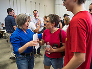 """15 JUNE 2019 - BOONE, IOWA: US Senator JONI ERNST (R-IA) talks to Iowa Republicans at """"Joni's Roast and Ride,"""" a motorcycle ride / fund raiser hosted by Ernst. Ernst, Iowa's junior US Senator, kicked off her re-election campaign during the """"Roast and Ride"""", an annual fund raiser and campaign event has she held since originally being elected to the US Senate in 2014.    PHOTO BY JACK KURTZ"""