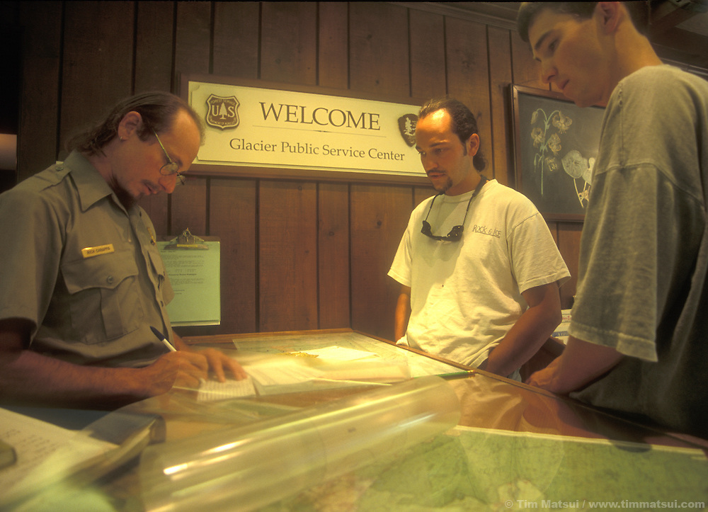Ranger Rick Chrapps registers Forrest Murphy and Dan Aylward for a North Pickets traverse in the North Cascades National Park.