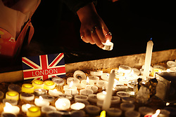 © Licensed to London News Pictures.23/03/2017.London, UK. A vigil is held in Trafalgar Square, London, to remember those killed in the Westminster terror attack, the day after a lone terrorist killed 4 people and injured several more, in an attack using a car and a knife. The attacker managed to gain entry to the grounds of the Houses of Parliament, killing one police officer.Photo credit: Tolga Akmen/LNP