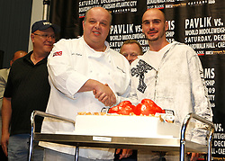 """Sept 29, 2009; East Rutherford, NJ, USA; Kelly Pavlik (r) receives a cake from Mauro Castano, one of the stars the the TLC show """"The Cake Boss"""" during the press conference announcing the December 5, 2009 World Middleweight Championship fight between Kelly Pavlik and Paul Williams. The two will meet at Boardwalk Hall in Atlantic City, NJ.  Mandatory Credit: Ed Mulholland"""