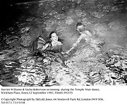 Harriet Williams &amp; Sacha Robertson swimming  during the Temple Muir dance, Wickham Place, Essex. 12 September 1981. Film81391f35<br />