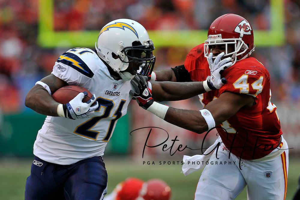 Running back LaDainian Tomlinson #21 of the San Diego Chargers throws a stiff-arm at free safety Jarrad Page #44 of the Kansas City Chiefs during the first quarter at Arrowhead Stadium in Kansas City, Missouri.  ..