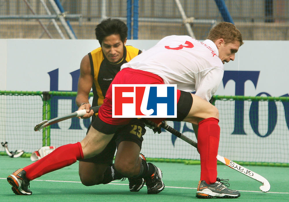 Kakamigahara, Gifu-Japan : Jalil Tengku Ahmad Tajuddin of Malaysia who scored two goals and Juszczak Miroslaw of Poland in a tussle for the ball at the Olympic Hockey Qualifier in Gifu Perfectural Green Stadium at Kakamigahara on 05 April 2008. Tengku Ahmad Tajuddin scored both the goals. Malaysia beat Poland 2-1.<br /> Photo: GNN/ Vino John
