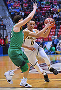 SAN DIEGO, CA - MARCH 16:  Landry Shamet #11 of the Wichita State Shockers drives against Jarrod West #13 of the Marshall Thundering Herd during a first round game of the Men's NCAA Basketball Tournament at Viejas Arena in San Diego, California. Marshall won 81-75.  (Photo by Sam Wasson)