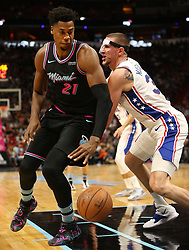 November 12, 2018 - Miami, FL, USA - The Heat's Hassan Whiteside drives to the basket past the 76ers' Mike Muscala in the second quarter as the Miami Heat host the Philadelphia 76ers on Monday, Nov. 12, 2018 at American Airlines Arena in Miami. (Credit Image: © Patrick Farrell/Miami Herald/TNS via ZUMA Wire)