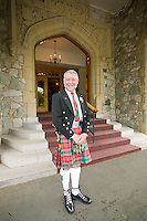The Lieutenant Governor's chauffeur in ceremonial regalia at Government House, the official residence of the Lieutenant Governor of British Columbia.  Victoria, British Columbia, Canada.