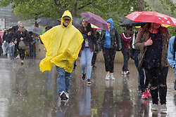 © Licensed to London News Pictures. 18/05/2016. LONDON, UK.  Tourists are caught in heavy downpours of rain near the Tower of London during wet weather in London today.  Photo credit: Vickie Flores/LNP