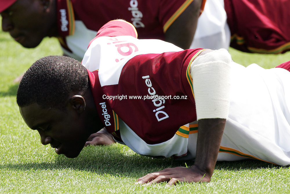 Jerome Taylor warms up during the West Indies cricket training at Eden Park, Auckland, New Zealand on Monday 13 February, 2006. The West Indies will play a Twenty20 cricket match against the Black Caps on Thursday. Photo: Hannah Johnston/Photosport<br /><br /><br /><br />145725