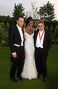 David Furnish, Naomi Campbell and Sir Elton John, Sir Elton John's White Tie and Tiara Ball. Windsor, 28 June 2003. © Copyright Photograph by Dafydd Jones 66 Stockwell Park Rd. London SW9 0DA Tel 020 7733 0108 www.dafjones.com