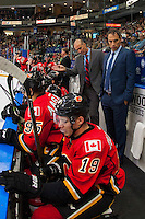 PENTICTON, CANADA - SEPTEMBER 17: Head coach Ryan Huska of the Calgary Flames speaks to players on the bench against the Edmonton Oilers on September 17, 2016 at the South Okanagan Event Centre in Penticton, British Columbia, Canada.  (Photo by Marissa Baecker/Shoot the Breeze)  *** Local Caption *** Ryan Huska;