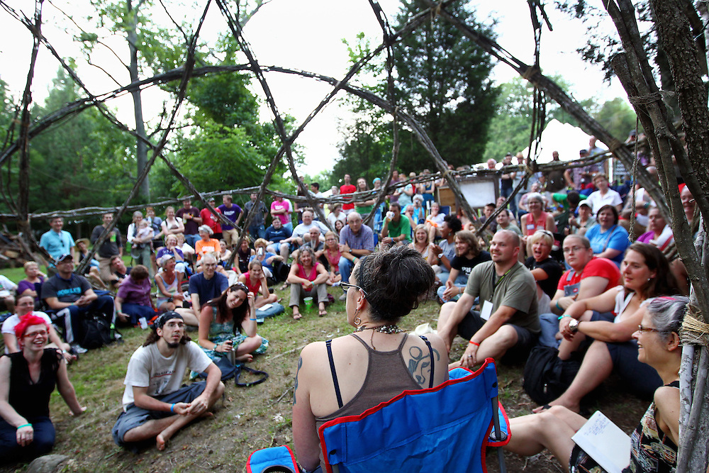 Denver pastor and author Nadia Bolz-Weber, in blue chair, speaks with a group in an outdoor geodesic dome at the Wild Goose Festival at Shakori Hills in North Carolina June 23, 2011.  (Photo by Courtney Perry)