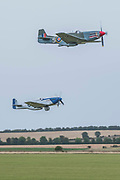 Two Mustangs take off - The Duxford Battle of Britain Air Show is a finale to the centenary of the Royal Air Force (RAF) with a celebration of 100 years of RAF history and a vision of its innovative future capability.