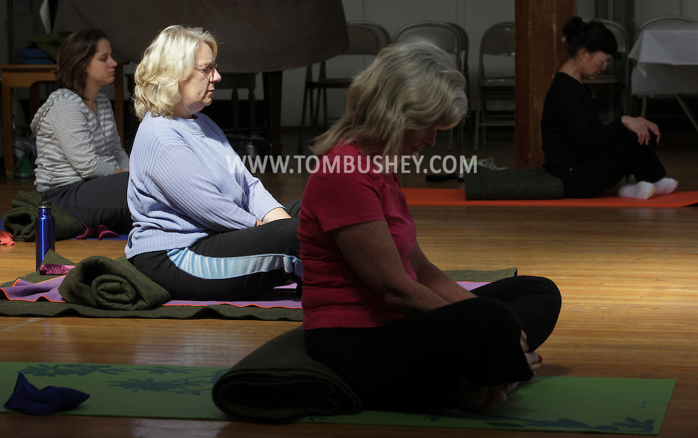 Middletown, New York -Instructor Maria Blon of Create Your Wellness leads a yoga class at the First Presbyterian Church on April 21, 2011.