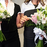 CeCe Pinhiero and Darlene Wilcox hold hands in their coordinated outfits as the women become legally married in a ceremony at the County Governement Center in Santa Cruz, California on Tuesday June 17, 2008.