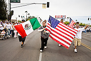 10 APRIL 2006 - PHOENIX, AZ: Marchers carry Mexican and American flags during an immigration protest in Phoenix, AZ. More than 200,000 people participated in a march for immigrants's rights in Phoenix Monday. The march was a part of a national day of action on behalf of undocumented immigrants. There were more than 100 such demonstrations across the US Monday. Protestors were encouraged to wear white, to symbolize peace, and wave American flags, to demonstrate their patriotism to the US.  Photo by Jack Kurtz