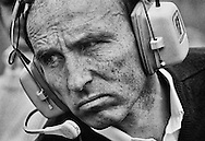 This 1980 portrait of team owner Frank Williams says perhaps more about his dogged determination and business acumen than his resume. Williams had just won his first  Constructor's Championships and the first of seven World Driver's Championships, but his grim no-nonsense visage made it clear he was just starting. Williams would win eight more Constructor's titles between 1982 and 1997. <br />