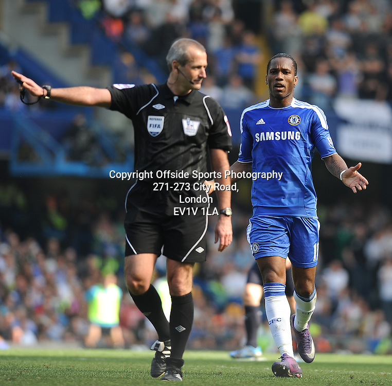 24/03/2012 - Barclays Premier League Football - 2011-2012 - Chelsea v Tottenham Hotspur - Didier Drogba of Chelsea ref Martin Atkinson. - Photo: Charlie Crowhurst / Offside.