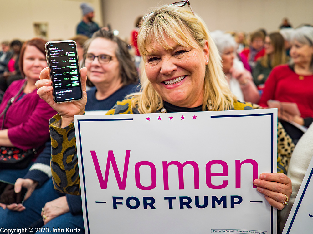 16 JANUARY 2020 - DES MOINES, IOWA: TERESA VAN LOON, from Ankeny, IA, holds up her phone with the stocks app showing the markets are up during the Women for Trump rally in Airport Holiday Inn in Des Moines. Van Loon said it was proof that the economy was doing well under President Trump's leadership. About 200 women attended the event, which featured Lara Trump, Mercedes Schlapp, and Kayleigh McEnany, surrogates on the campaign trail for President Donald Trump.          PHOTO BY JACK KURTZ