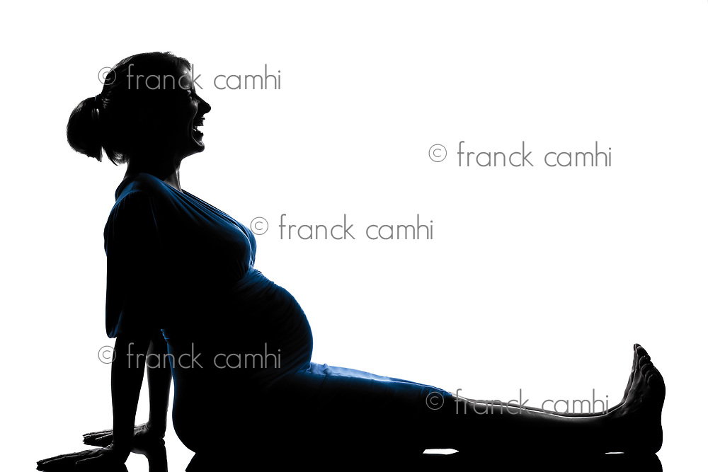 beautiful caucasian pregnant woman laughing happy in silhouette on studio isolated white background