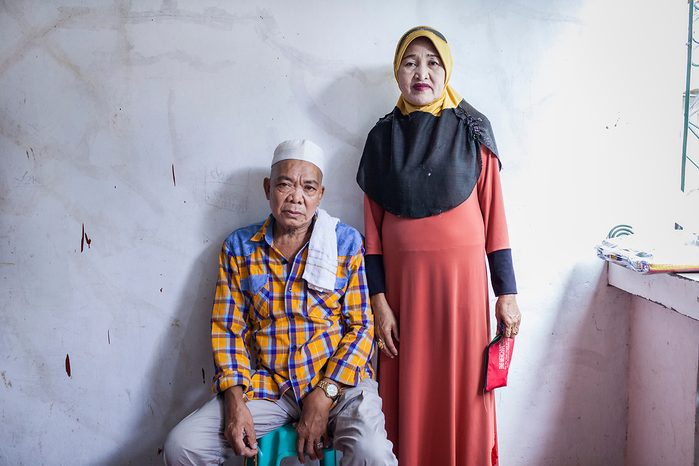 Davao City, Mindanao, Philippines - JUNE 22: A portrait of Abdul Jabbar Sultan and his wife.  Abdul fled Marawi after the ISIS backed Maute Group has sieged the city. They found refuge in a house that she shared with 30 other people in the Mini Forest Barangay 23C. Currently, over 570 families and roughly 2500 evacuees from Marawi reside in the area.