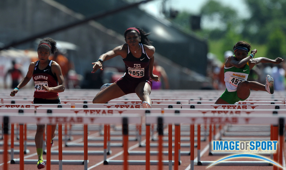 Mar 31, 2012; Austin, TX, USA; Donique Flemings of Texas A&M (center) defeats Kori Carter of Stanford (left) and Tiffani McReynolds of Baylor to win the womens 100m hurdles in a wind-aided 12.88 in the 85th Clyde Littlefield Texas Relays at Mike A. Myers Stadium.