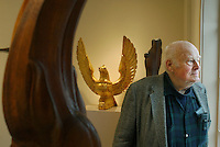 Gloucester: James McClellan, of Ipswich, stands among some of his sculptures at the Cape Ann Historical Museum Wednesday. McClellan has his work on exhibit at the museum through January 31, 2003. (Photo by Mike Dean/Gloucester Daily Times). Wednesday, December 11, 2002 (NOTE: THIS IS A DIGITAL CAMERA IMAGE)..**************************************.Filter: Min (QMPro: Red Radius:0/Blue Radius:6/Desp.).USM: Normal (Amt:200/Radius:0.3/Thresh:2).File Size: 7.65MB.Original file name: DSC_5000.JPG
