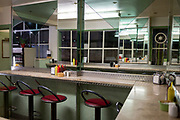 As the Coronavirus pandemic spreads across the UK, businesses and entertainment venues not already closed with the threat of job losses, struggle to stay open with growing rumours of a lockdown and travel restrictions around the capital. As Londoners work from home, counters remain empty in a City of London diner, on 19th March 2020, in London, England.
