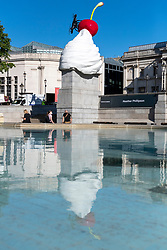 © Licensed to London News Pictures. 30/07/2020. London, UK. Unveiling of there Forth Plinth sculpture titled 'The End' by artist Heather Phillipson. The sculpture in Trafalgar Square consists of a fly and drone stuck on top of a giant ice cream cone. Photo credit: Ray Tang/LNP