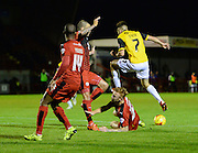 Northampton  midfielder Lawson D'Ath is tackled by Crawley defender Josh Yorwerth during the Sky Bet League 2 match between Crawley Town and Northampton Town at the Checkatrade.com Stadium, Crawley, England on 24 November 2015. Photo by David Charbit.