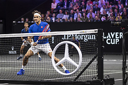 September 21, 2018 - Chicago, Illinois, U.S - Team Europe member ROGER FEDERER of Switzerland plays at the net while teammate NOVAK DJOKOVIC of Serbia covers the baseline during the first doubles match on Day One of the Laver Cup at the United Center in Chicago, Illinois. (Credit Image: © Shelley Lipton/ZUMA Wire)