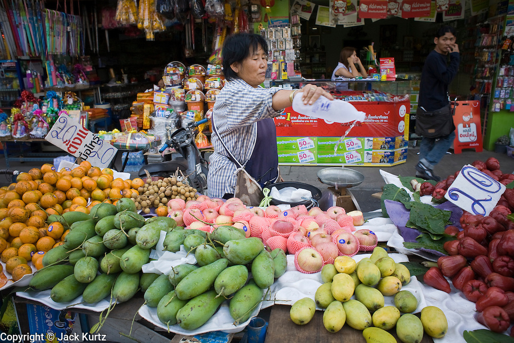 20 FEBRUARY 2008 -- KANCHANABURI, THAILAND: Fruit vendors in the market in Kanchanaburi, Thailand.  Photo by Jack Kurtz