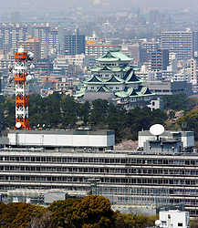 Skyline of Nagoya city with historic castle in the distance