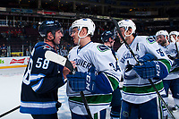 PENTICTON, CANADA - SEPTEMBER 8: Jansen Harkins #58 of Winnipeg Jets shakes hands with Jakob Stukel #34 of Vancouver Canucks at the end of the game on September 8, 2017 at the South Okanagan Event Centre in Penticton, British Columbia, Canada.  (Photo by Marissa Baecker/Shoot the Breeze)  *** Local Caption ***
