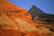 Sunset light on eroded cliffs of Capitol Reef, Capitol Reef National Park, UTAH