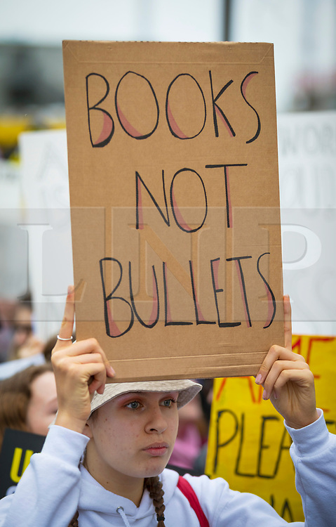 © Licensed to London News Pictures. 24/03/2018. London, UK. Protesters join the 'March For Our Lives' outside the US Embassy in London to demand strict gun control following the school shooting in Parkland, Florida in which 17 people were killed. Organised by survivors of the Stoneman Douglas High School shooting, marches for stricter gun control are taking place across the USA and around the world. Photo credit: Rob Pinney/LNP
