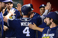 PHOENIX, AZ - JULY 05:  Wil Myers #4 of the San Diego Padres is congratulated by teammates after scoring against the Arizona Diamondbacks during the third inning at Chase Field on July 5, 2016 in Phoenix, Arizona.  (Photo by Jennifer Stewart/Getty Images)