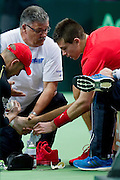 (R) Borna Coricof Croatia injured during the BNP Paribas Davis Cup 2014 between Poland and Croatia at Torwar Hall in Warsaw on April 4, 2014.<br /> <br /> Poland, Warsaw, April 4, 2014<br /> <br /> Picture also available in RAW (NEF) or TIFF format on special request.<br /> <br /> For editorial use only. Any commercial or promotional use requires permission.<br /> <br /> Mandatory credit:<br /> Photo by &copy; Adam Nurkiewicz / Mediasport