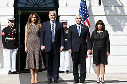 U.S. President Donald Trump, First Lady Melania Trump, Vice-President Mike Pence and Karen Pence lead a moment of silence with White House staff for the victims of the Las Vegas shooting, on the South Lawn of the White House in Washington, D.C., U.S., Oct. 2, 2017. Photo by Olivier Douliery/ Abaca Press