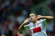 Poland's Robert Lewandowski celebrates after scoring during the 2014 World Cup Qualifying Group H football match between Poland and Montenegro at National Stadium in Warsaw on September 06, 2013.<br /> <br /> Poland, Warsaw, September 06, 2013<br /> <br /> Picture also available in RAW (NEF) or TIFF format on special request.<br /> <br /> For editorial use only. Any commercial or promotional use requires permission.<br /> <br /> Mandatory credit:<br /> Photo by © Adam Nurkiewicz / Mediasport
