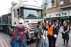 London, UK. 16th April 2019. Climate campaigners from Extinction Rebellion block one lane of Edgware Road during the second day of International Rebellion UK activities by climate campaigners from Extinction Rebellion to call on the Government to take urgent action to address climate change.
