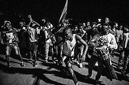 A group of migrants dancing during a solidarity rally organized by local musicians