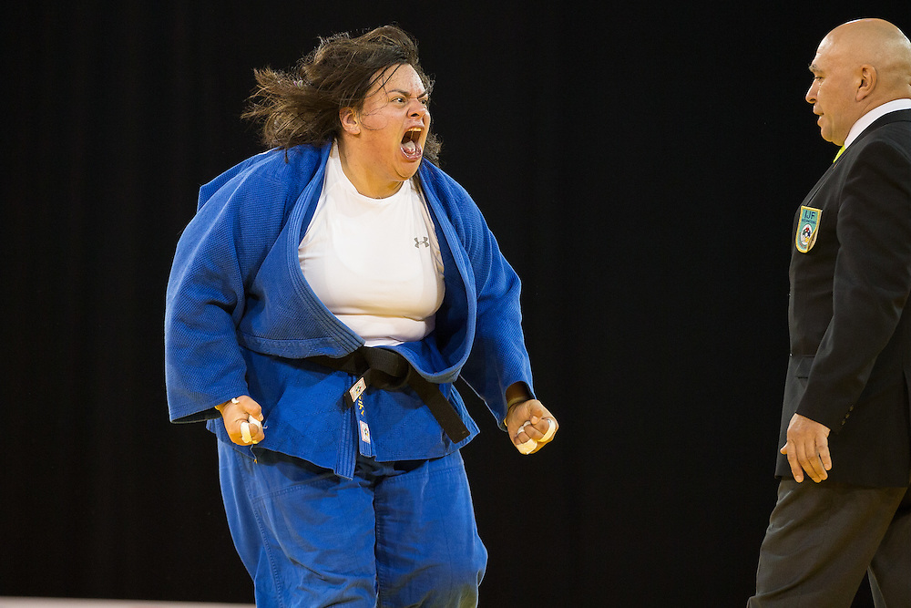 Vanessa Zambotti of Mexico celebrates her win over Maria Suelen Altheman during their women's judo -78kg class final of the table at the 2015 Pan American Games in Toronto, Canada, July 14,  2015.  AFP PHOTO/GEOFF ROBINS