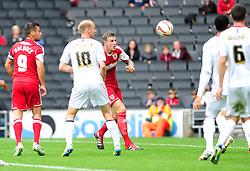 Bristol City's Aden Flint heads the ball towards goal  - Photo mandatory by-line: Dougie Allward/JMP - Tel: Mobile: 07966 386802 24/08/2013 - SPORT - FOOTBALL - Stadium MK - Milton Keynes -  Milton Keynes Dons V Bristol City - Sky Bet League One
